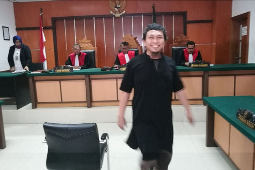 Suryadi Mas'ud leaving the courtroom on Jan 30 after judges postponed the hearing to next week.