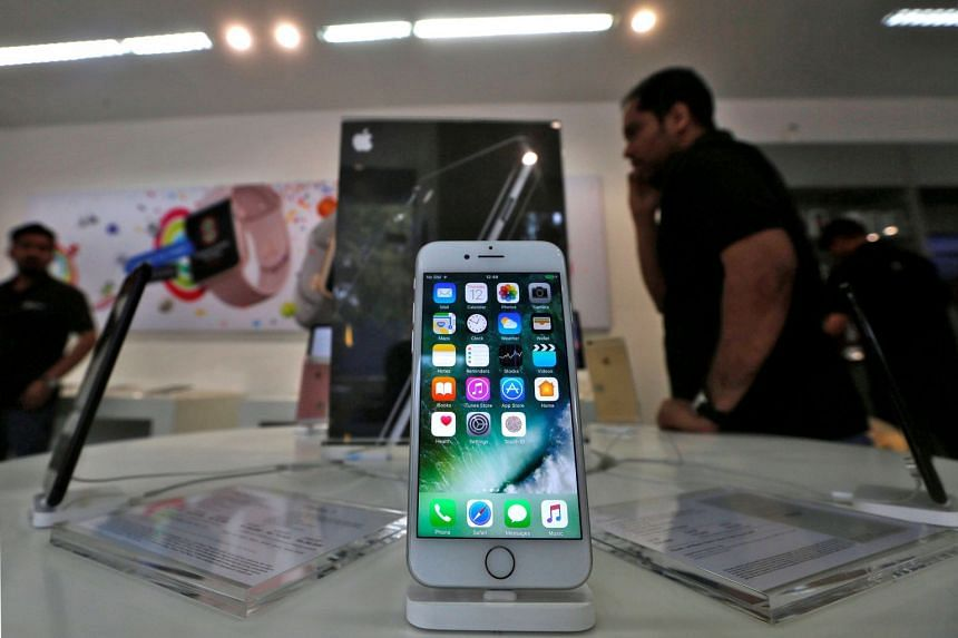 An iPhone is seen on display at an Apple reseller store in Mumbai, India.