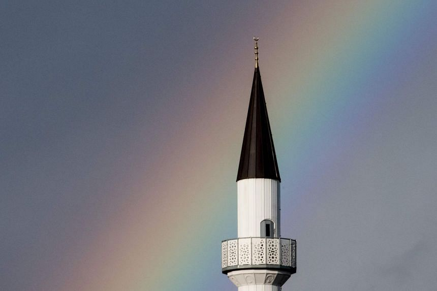 A rainbow shines above the minaret of the DITIB Mosque in Kehl, southwestern Germany.