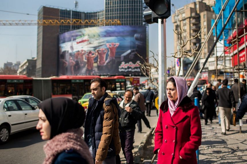 Pedestrians on the streets of Teheran, Iran, on Feb 8, 2017.
