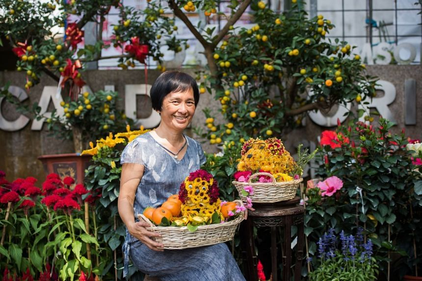 Candy Floriculture owner Sharon Goh with her dog-themed novelty creations.