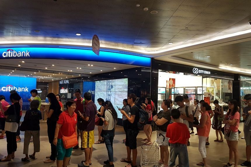 People queueing outside an OCBC branch at Waterway Point on Feb 4, 2018.
