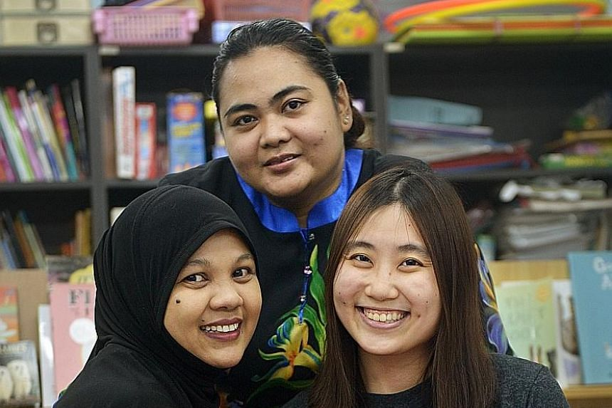 (From left) : Rental flat residents Suraiyah Mohamed Ghaus and Marianna Bajuri met lawyer Ada Chua, who lives in a condominium, at a picnic. They got along well and Ms Chua was impressed by the resourcefulness and talent of some of the children from