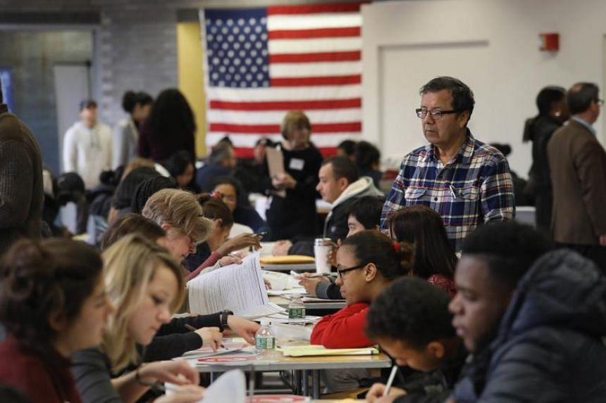 Immigrants receive assistance with their US citizenship applications at a Citizenship Now! event held by the City University of New York on Feb 3, 2018.