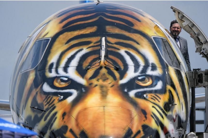 An Embraer E190-E2, which has a tiger's face spray-painted on it as a mark of respect to Asia, on display during a media preview of the Singapore Airshow on Feb 4, 2018.