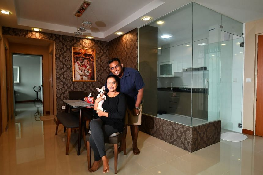 Mr Mohan Raj Velippan and his wife, Ms Ambika Rajumoothy, opted for glass panels for their kitchen.