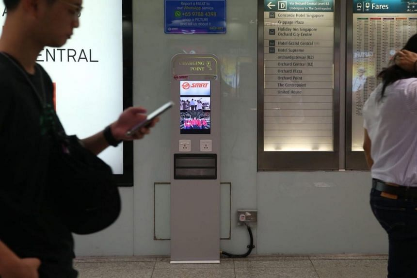 A charging kiosk at Somerset MRT Station. Similar kiosk are installed at 30 MRT stations and comes with digital screens for commuters to view next train arrival timings as they charge their mobile devices.