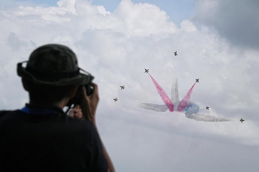 South Korea's Black Eagles performing at a preview of the Singapore Airshow yesterday. The airshow, which kicks off tomorrow, is expected to draw more than 130,000 visitors.