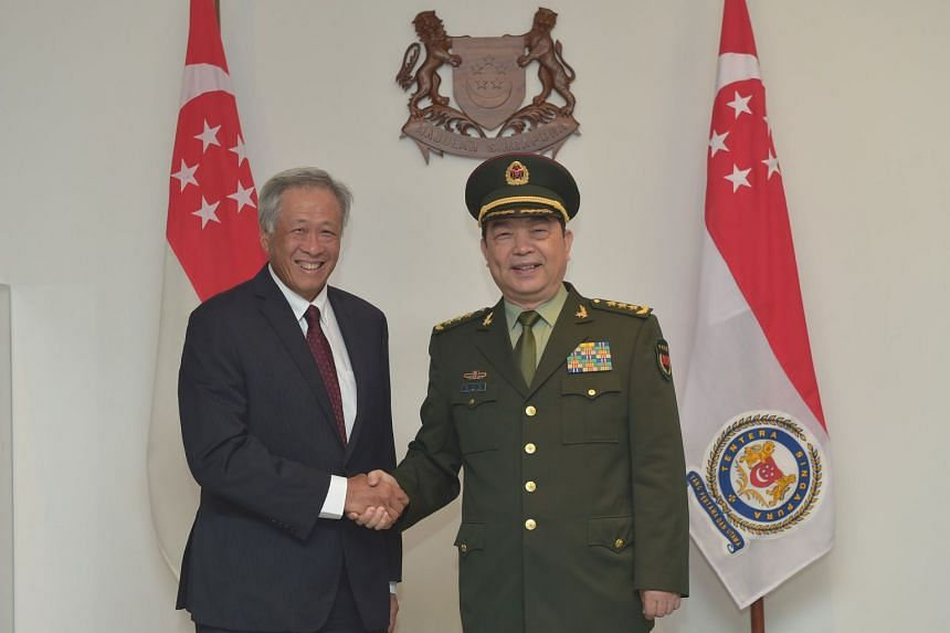 Defence Minister Ng Eng Hen welcoming his Chinese counterpart, General Chang Wanquan, during the latter's introductory visit to Singapore on Feb 5, 2018.