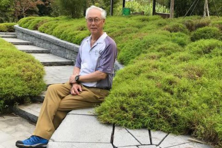 """ESM Goh posted photos of himself and an unidentified man on Facebook, accompanied by the caption, """"I watch as he ruminates in the calmness of Learning Forest, far from the maddening crowd""""."""