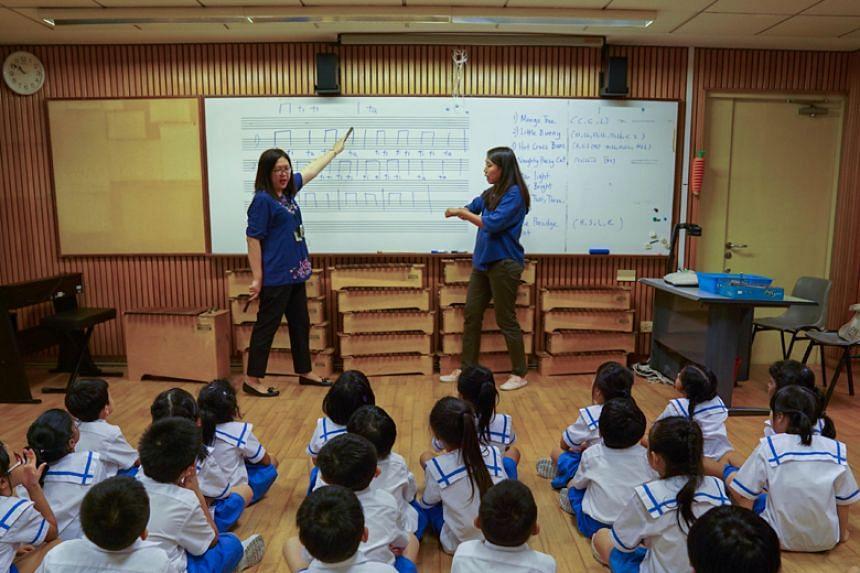 Ms Lee Siew Foong (left), Mayflower Primary School's head of department for aesthetics, teaching music alongside Ms Bernadette Pung, an educational sign interpreter.