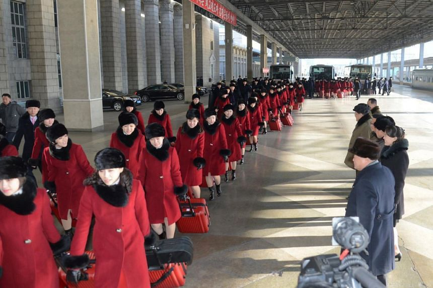 A North Korean art troupe leaves to give a congratulatory performance for the 23rd Winter Olympics in South Korea on Feb 5, 2018.