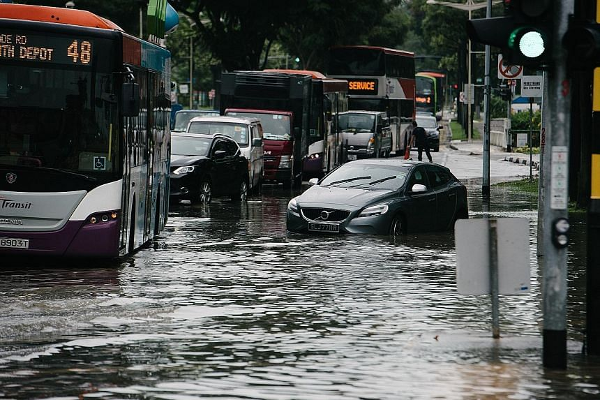 The scene at the junction of Upper Changi Road and Bedok North Avenue 4 on Jan 8. With climate change, Singapore can expect intense rainfall to be the norm in future, said Minister for the Environment and Water Resources Masagos Zulkifli. He said dra