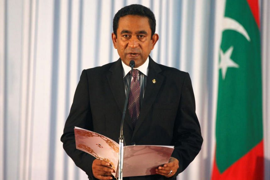 Abdulla Yameen takes his oath as the President of Maldives during a swearing-in ceremony at the parliament in Male on Nov 17, 2013.