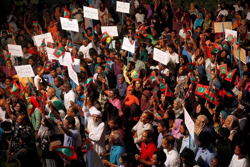Opposition supporters protest against the government's delay in releasing their jailed leaders, including former president Mohamed Nasheed, despite a Supreme Court order, in Male, Maldives, on Feb 4, 2018.