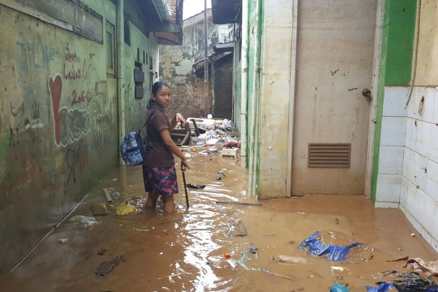 In Rawa Jati area in South Jakarta, water has receded from 2-metres high several hours ago. Residents have started cleaning and are trying to save their valuables.
