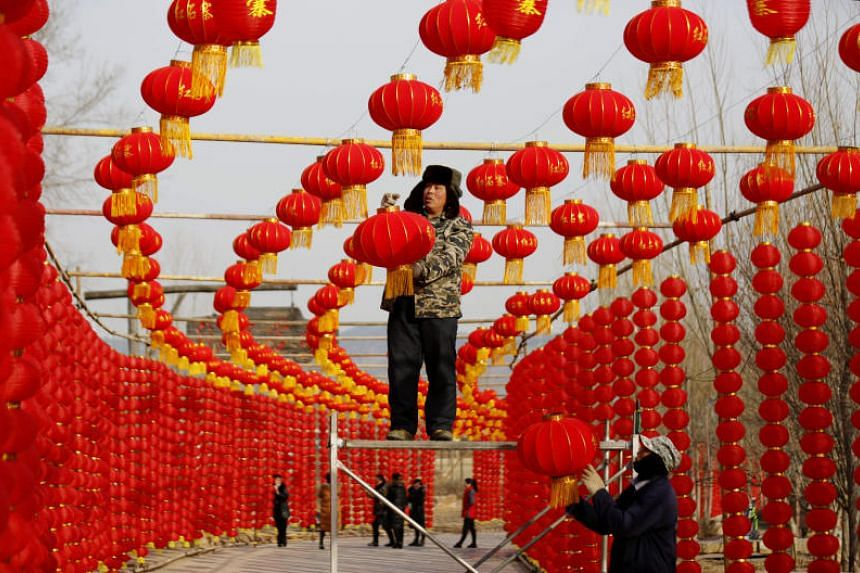 Workers installing red lanterns ahead of the Chinese Lunar New Year at a tourist attraction in Linyi, Shandong province, China, on Jan 31, 2018.