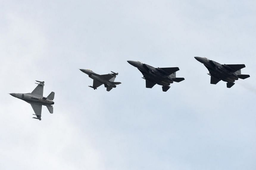 The Republic of Singapore Air Force (RSAF)'s F-15SG and F-16C fighter aircrafts in an aerial display on May 21, 2016.