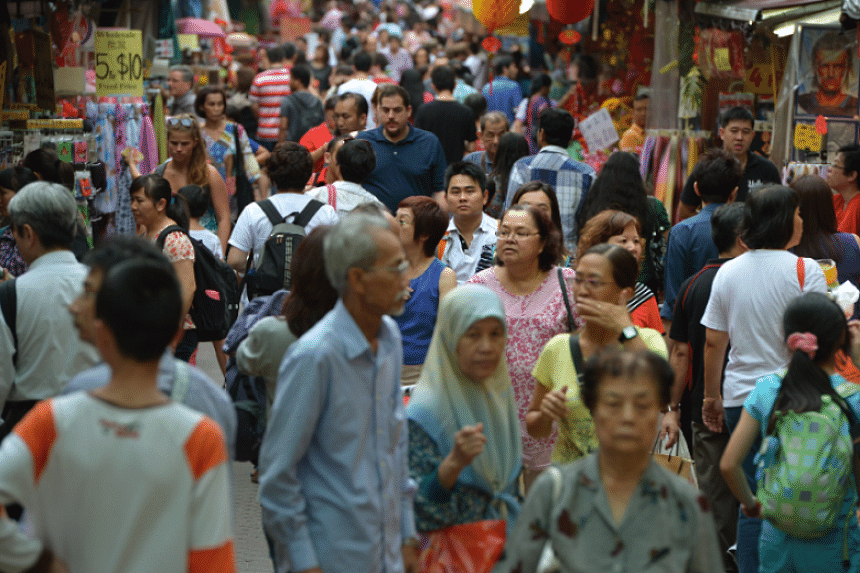 Multiple agencies are involved in encouraging integration between classes, such as urban planners designing shared spaces like hawker centres and playgrounds.