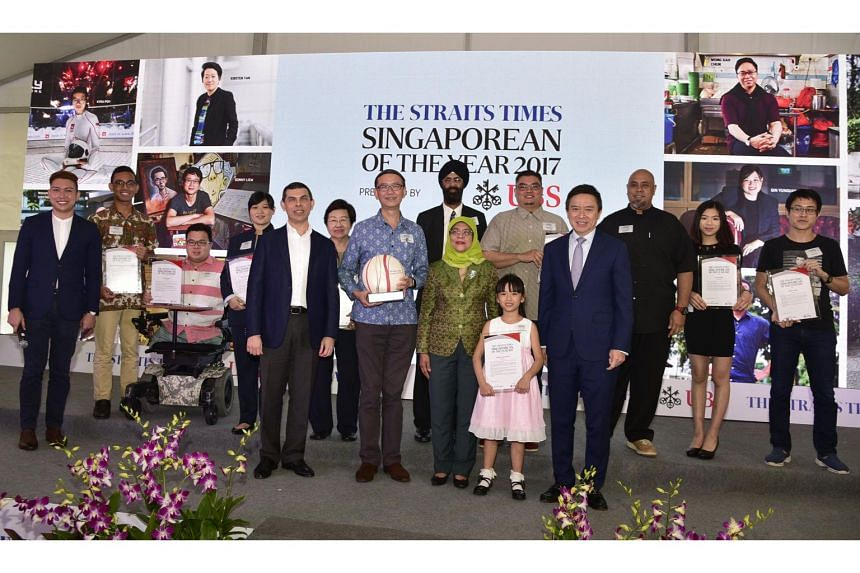 The finalists of The Straits Times Singaporean of the Year 2017 pose for a group photo with President Halimah Yacob.