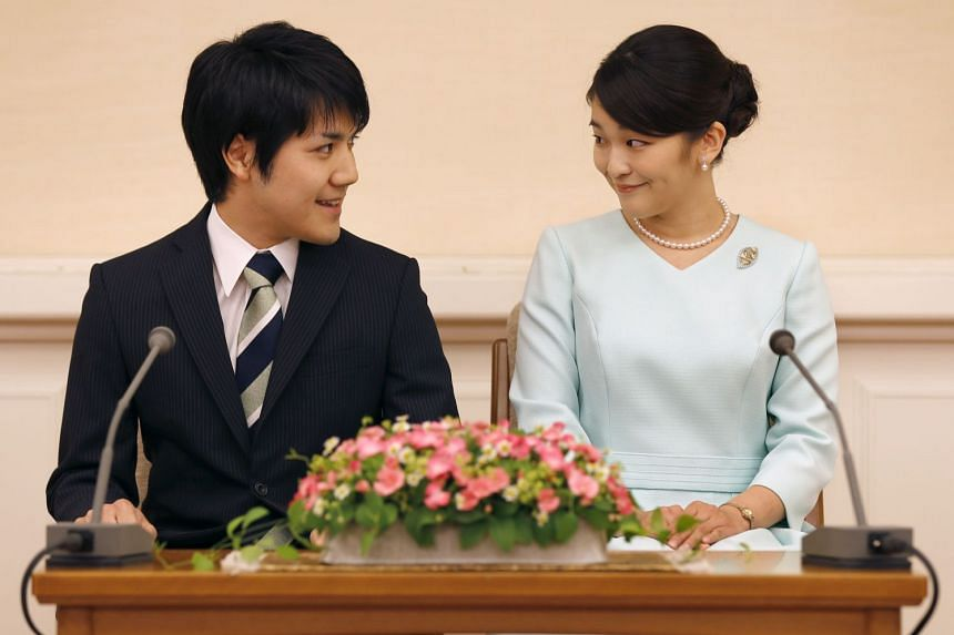 Japan's Princess Mako and commoner Kei Komuro had been planning to marry this year but want more time to arrange their ceremony and prepare for married life.