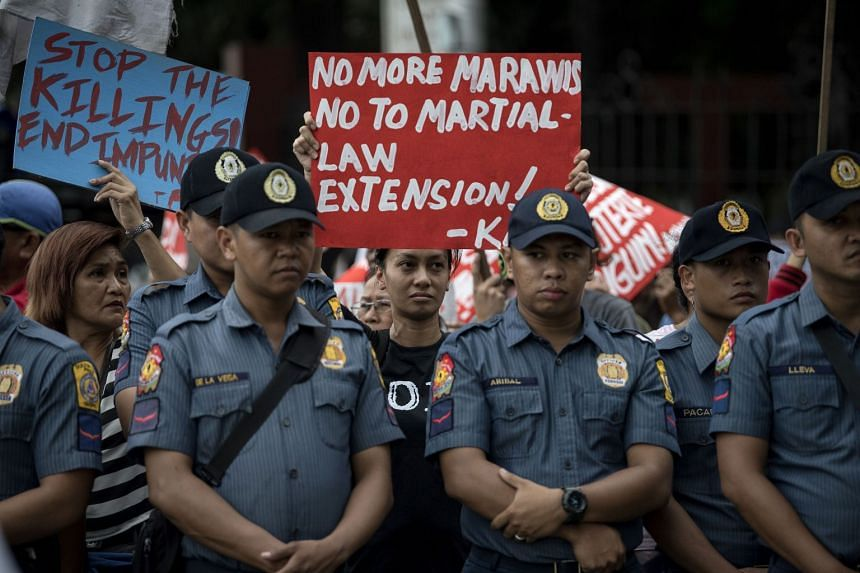 Protesters at the gate of the House of Representatives in Manila, denouncing the Congress move to extend martial law in Mindanao on Dec 13, 2017.