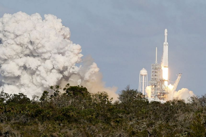 The SpaceX Falcon Heavy rocket lifts off at the Kennedy Space Centre in Cape Canaveral, Florida.
