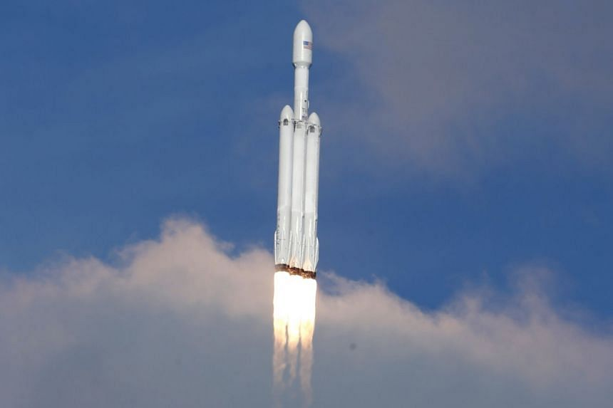 The SpaceX Falcon Heavy rocket climbs towards space after lifting off from the Kennedy Space Centre.