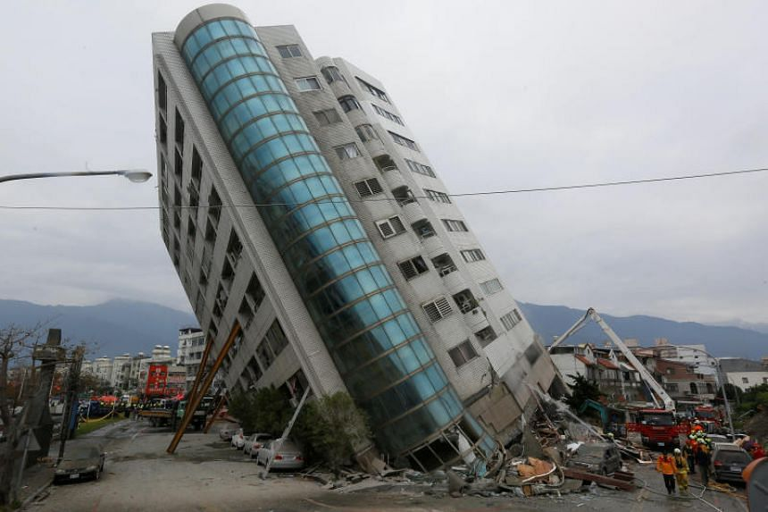 Rescue workers are seen at a damaged building after an earthquake hit Hualien, Taiwan on Feb 7, 2018.