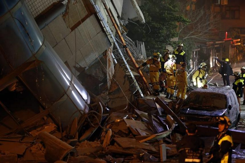 Rescue services officers searching for survivors in a damaged building in Hualien, Taiwan, on Feb 7, 2018.