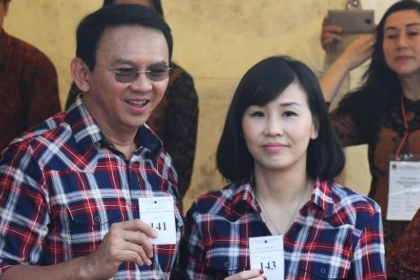 Then Jakarta governor Basuki Tjahaja Purnama and his wife Veronica after casting their votes in Jakarta, on Feb 15, 2017.