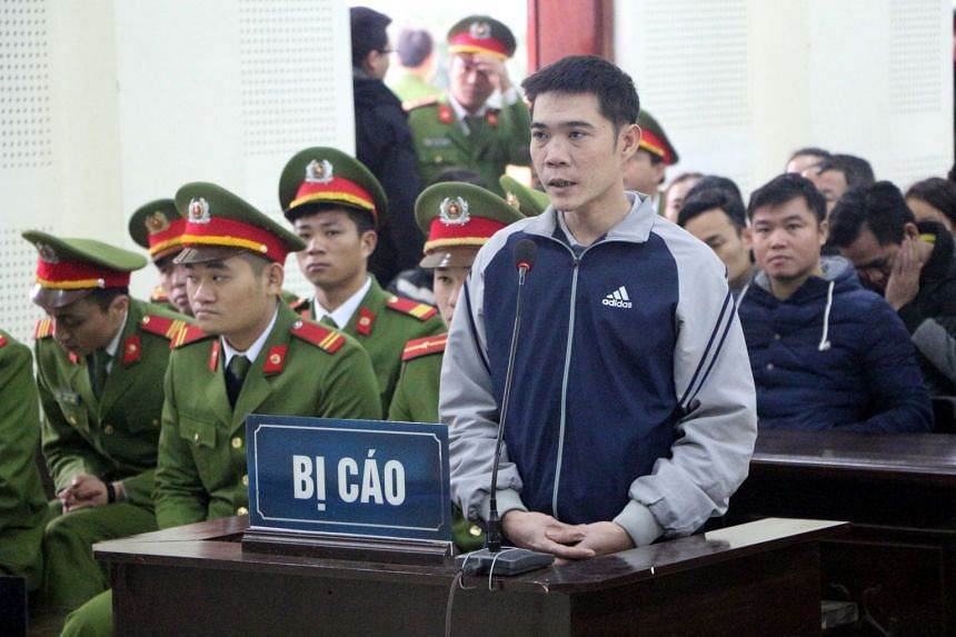 Vietnamese activist Hoang Duc Binh standing inside the courtroom in Nghe An, Vietnam, on Feb 6, 2018.
