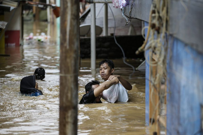 Thousands of residents have been evacuated in flood-hit Jakarta.