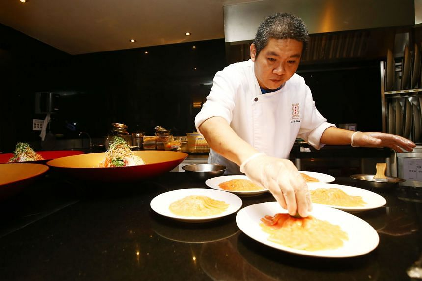 Food being prepared at TungLok Signatures. The Chinese restaurant chain is one of the firms working with the HPB to re-work dishes to include sugar alternatives. Many Asian foods such as pad thai and sambal chilli rely on sugar to bring out the flavo