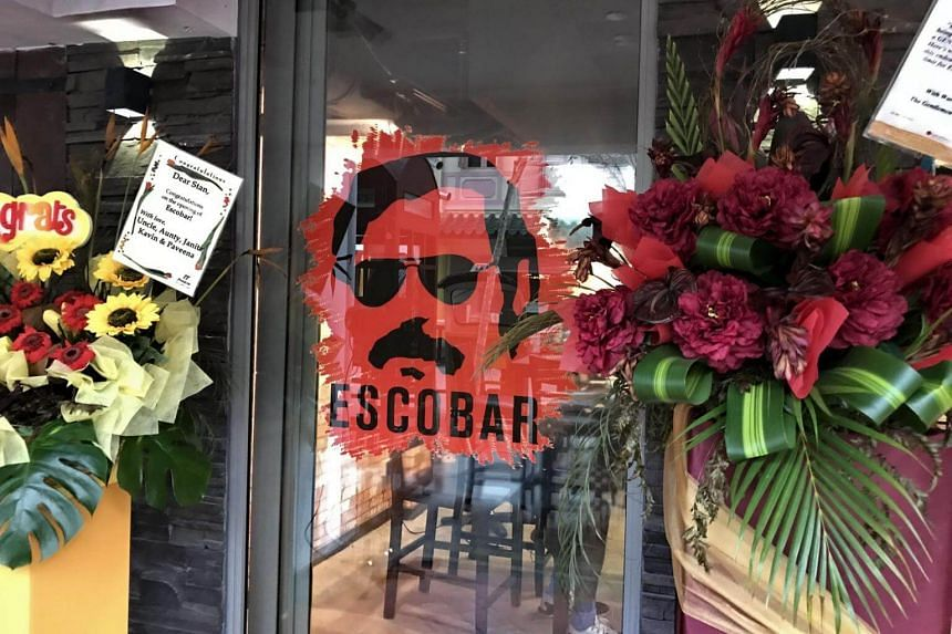 Several bouquets stood on stands by the door next to a decal of Escobar's face, congratulating the eatery on its recent opening.