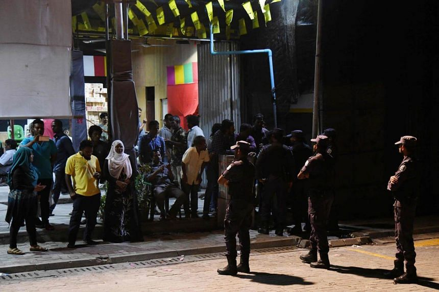 Security forces stand outside the Maldivian Democratic Party (MDP) office as they barricade it on Frb 7, 2017.
