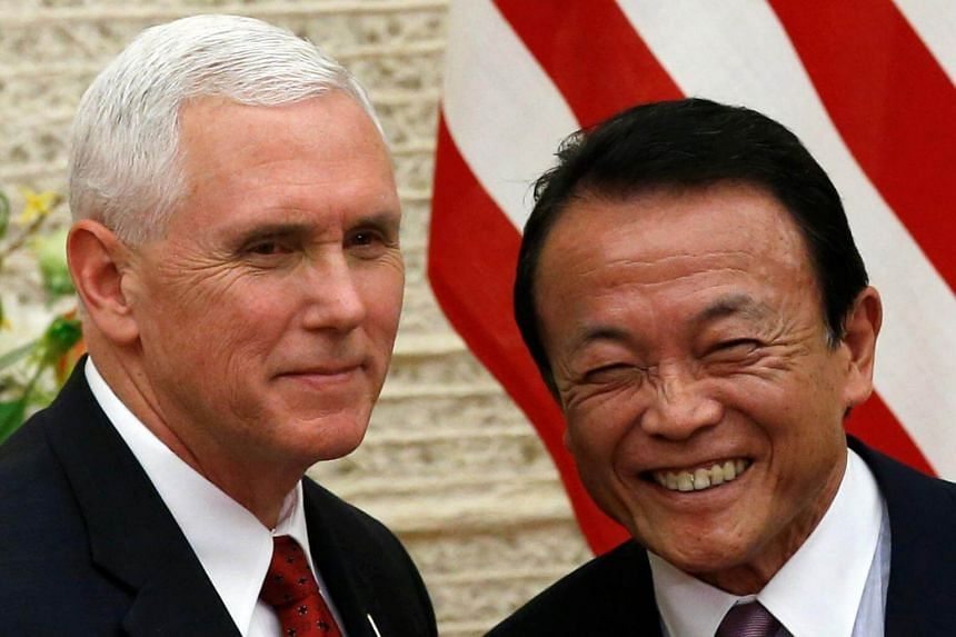 US Vice President Mike Pence and Japan's Deputy Prime Minister Taro Aso attending a joint news conference after their talks in Tokyo on April 18, 2017.