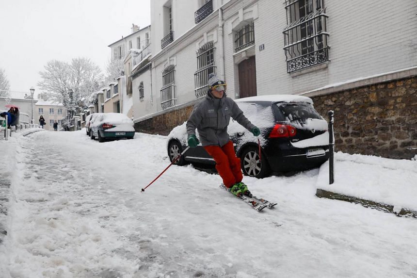 A man skis on a snow covered street of Montmartre, following heavy snowfall in Paris on Feb 7, 2018.