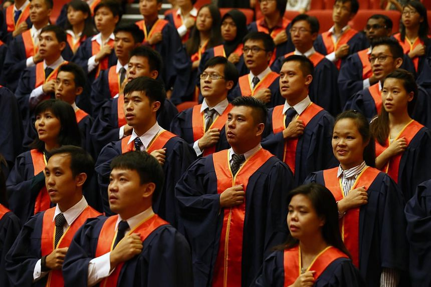 NIE graduates taking their pledge during the NIE investiture ceremony on Jan 12, 2016. Non-graduate educators are slowly disappearing from the education service, with only around 13 per cent of them in the service in 2016.