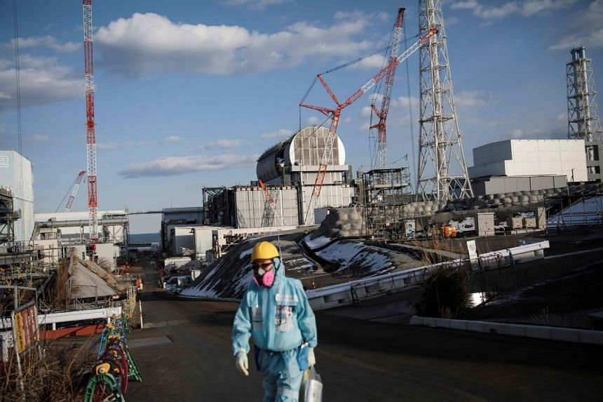 A Tokyo Electric Power Company (Tepco) employee working near the reactors at the Fukushima Dai-ichi nuclear plant on Jan 31, 2018.