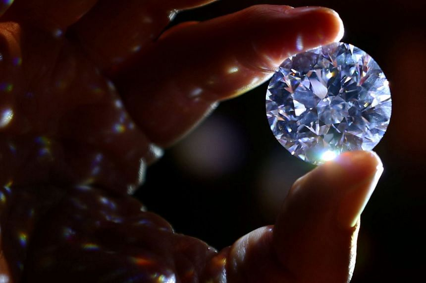 The diamond (above) weighs just over 102 carats.