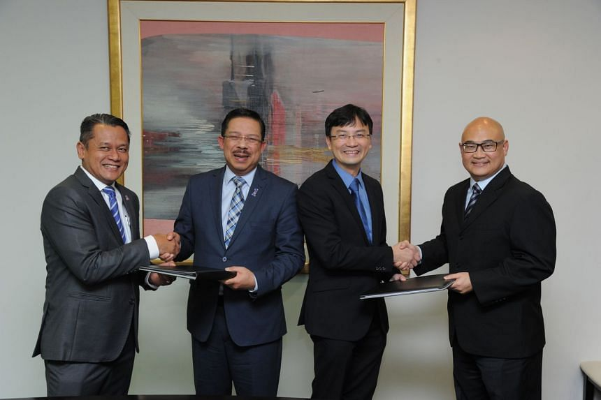(From left) Megat Khairulazhar Khairodin, chief financial officer of Prasarana, Datuk Seri Mohd Zuki bin Ali, Senior Deputy Secretary-General in the Malaysian Prime Minister's Department, Mr Ngien Hoon Ping, chief executive of the Land Transport Au