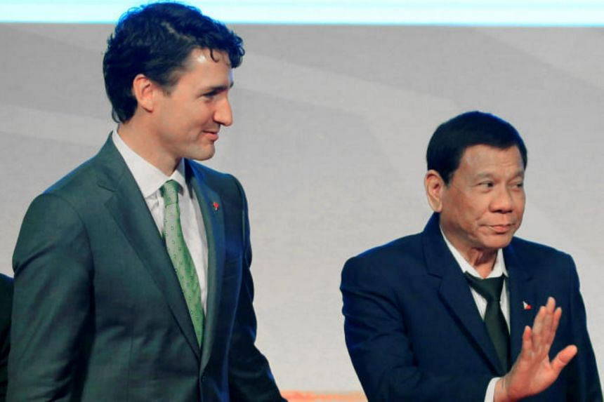 Philippine's President Rodrigo Duterte gestures while walking with Canada's Prime Minister Justin Trudeau after their family photo during the Asean-Canada 40th anniversary commemorative summit in metro Manila, Philippines on Nov 14, 2017.