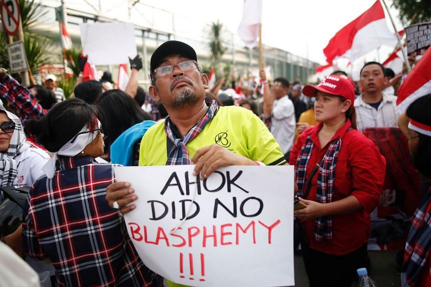 Supporters of former Jakarta Governor Basuki Tjahaja Purnama, also known as Ahok, stage a protest outside Cipinang Prison, where he was taken following his conviction of blasphemy, in Jakarta, Indonesia, on May 9, 2017.