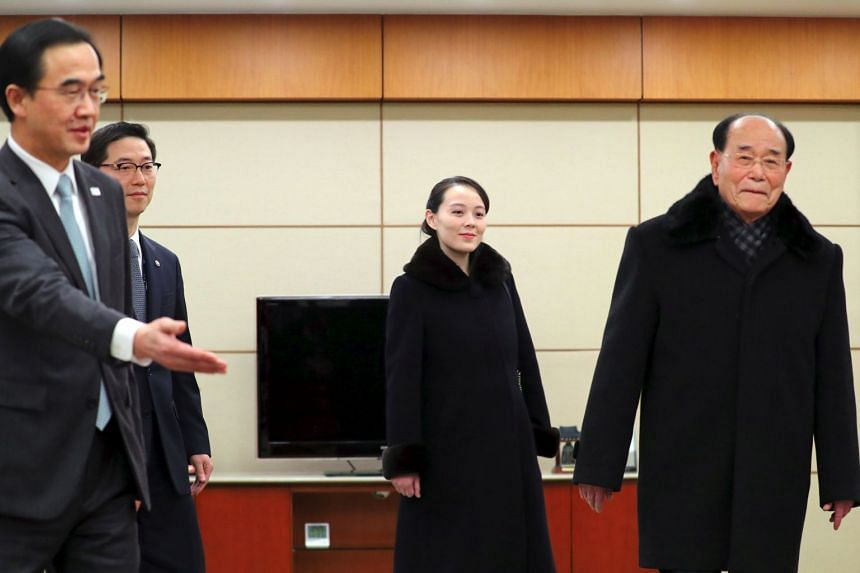 North Korea's ceremonial head of state Kim Yong Nam (right) and Kim Yo Jong (centre), North Korean leader Kim Jong Un's younger sibling, are greeted by South Korea's Unification Minister Cho Myoung Gyon (left) upon their arrival at Incheon airport, w