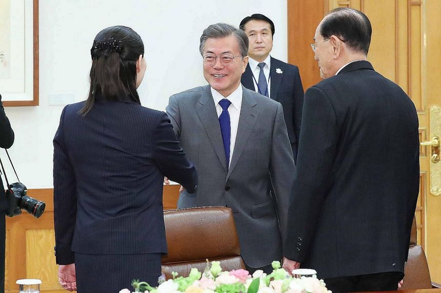 South Korea's President Moon Jae In greets Kim Yo Jong, North Korean leader Kim Jong Un's sister, and North Korea's ceremonial head of state, Kim Yong Nam, during their meeting at the presidential Blue House in Seoul on Feb 10, 2018.