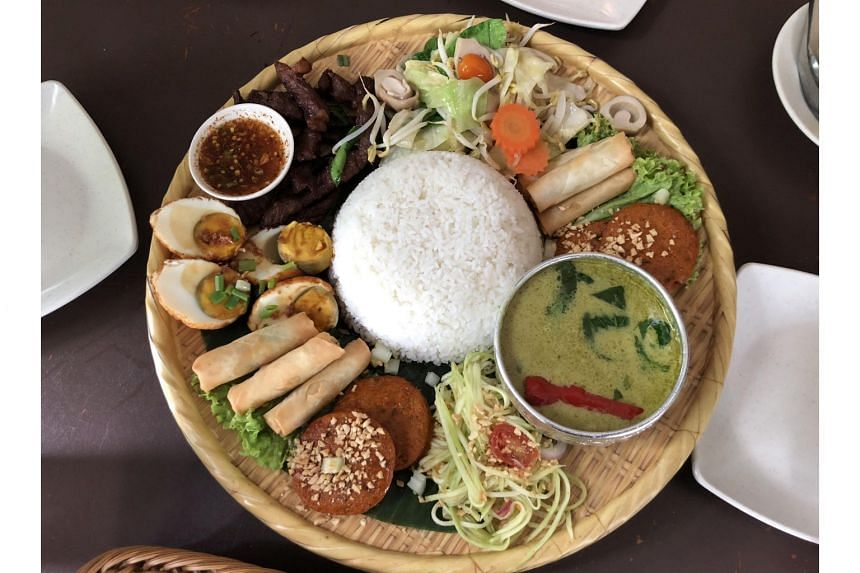 The Rice Platter has green curry with chicken, mango salad, vegetables, beef, spring rolls, fish cakes and eggs.