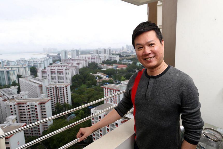 Mr Jackson Heng, director of Camford International College - in his 4-room flat at Marsiling Lane.