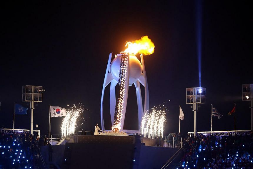 Yuna Kim, the profoundly popular South Korean figure skater, lights the cauldron during the opening ceremony of the 2018 Winter Olympics in Pyeongchang on Feb 9, 2018.