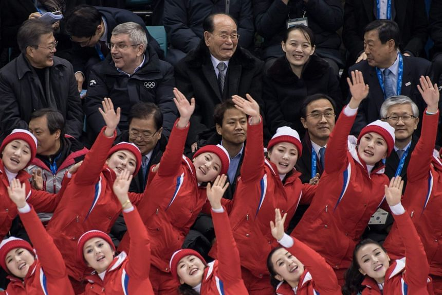 North Korean cheerleaders performs before (top, from left) South Korean President Moon Jae-in, president of the International Olympic Committee Thomas Bach, President of the Presidium of the Supreme People's Assembly of North Korea Kim Yong Nam, Kim